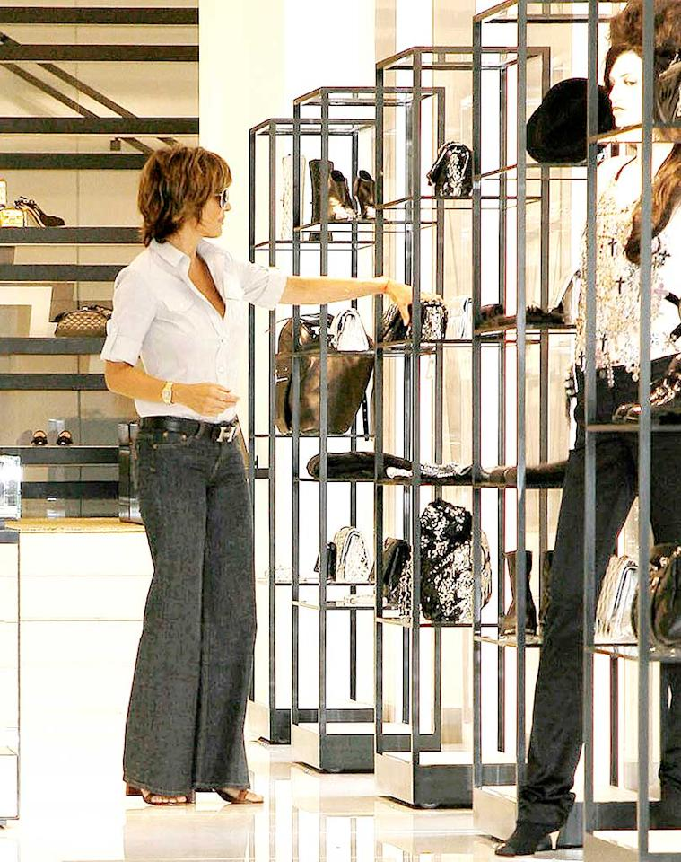 "We can't stop raving about how fantastic Lisa Rinna looks for 45, but we're also impressed with the impeccable new Chanel store the former ""Melrose Place"" vixen was spotted shopping at. Located on trendy Robertson Blvd., the concept boutique is known for its celeb clientele and one-of-a-kind items. SF/<a href=""http://www.splashnewsonline.com"" target=""new"">Splash News</a> - July 9, 2008"