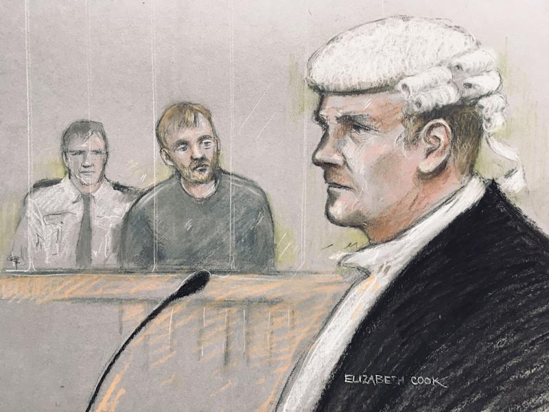 Court artist sketch by Elizabeth Cook of Stephen Nicholson, 25, (centre) of no fixed address in the dock at Winchester Crown Court, facing William Mousley QC, prosecuting, where he is accused of repeatedly stabbing 13-year-old Lucy McHugh in the neck and upper body in woodland at Southampton Sports Centre, before leaving her to die.