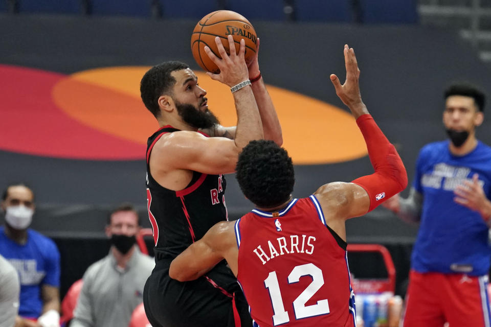 Toronto Raptors guard Fred VanVleet (23) shoots over Philadelphia 76ers forward Tobias Harris (12) during the second half of an NBA basketball game Sunday, Feb. 21, 2021, in Tampa, Fla. (AP Photo/Chris O'Meara)