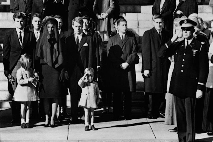 <p>Outside the Cathedral of St. Matthew the Apostle in Washington D.C., John F. Kennedy Jr. salutes his father's coffin. </p>