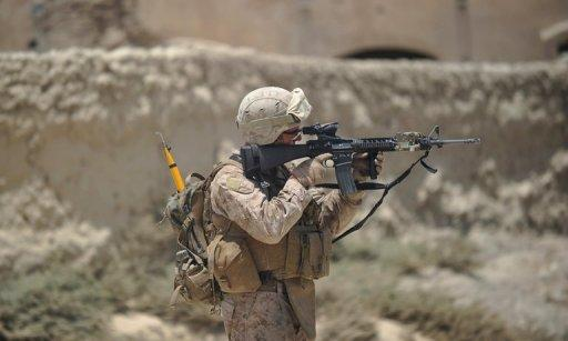A US Marine is seen on patrol in Helmand Province in June