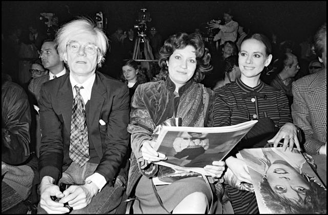 Andy Warhol, Andrea Ferreol and Claudine Auger attend the presentation of Enrico Coveri's Haute Couture fashion collection. (Photo by Bertrand Rindoff Petroff/Getty Images)