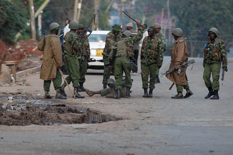 Police beat a man in Majengo, one of many towns in western Kenya where opposition protests spilled onto the streets (AFP Photo/Cyril VILLEMAIN)