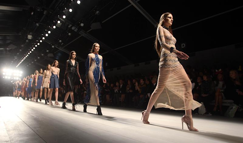 Models wear creations from Marios Schwab during London Fashion Week, Sunday, Sept. 16, 2012. (AP Photo/PA, Lewis Whyld) UNITED KINGDOM OUT