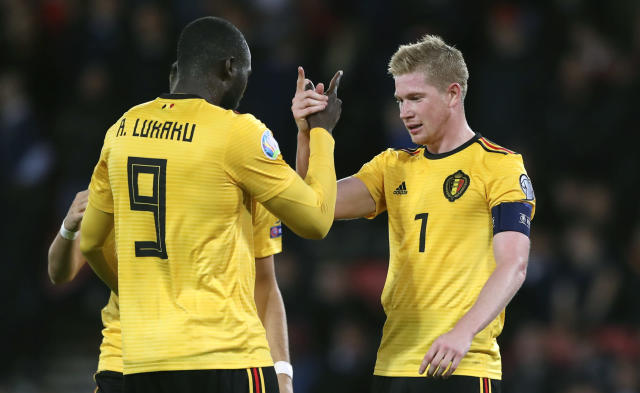 Belgium's Kevin De Bruyne, right, celebrates with with Belgium's Romelu Lukaku after scoring his sides fourth goal during the Euro 2020 group I qualifying soccer match between Scotland and Belgium at Hampden Park stadium in Glasgow, Monday, Sept. 9, 2019. (AP Photo/Scott Heppell)