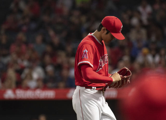 Shohei Ohtani left the game against the Royals after four innings with a blister on his middle finger. (AP)