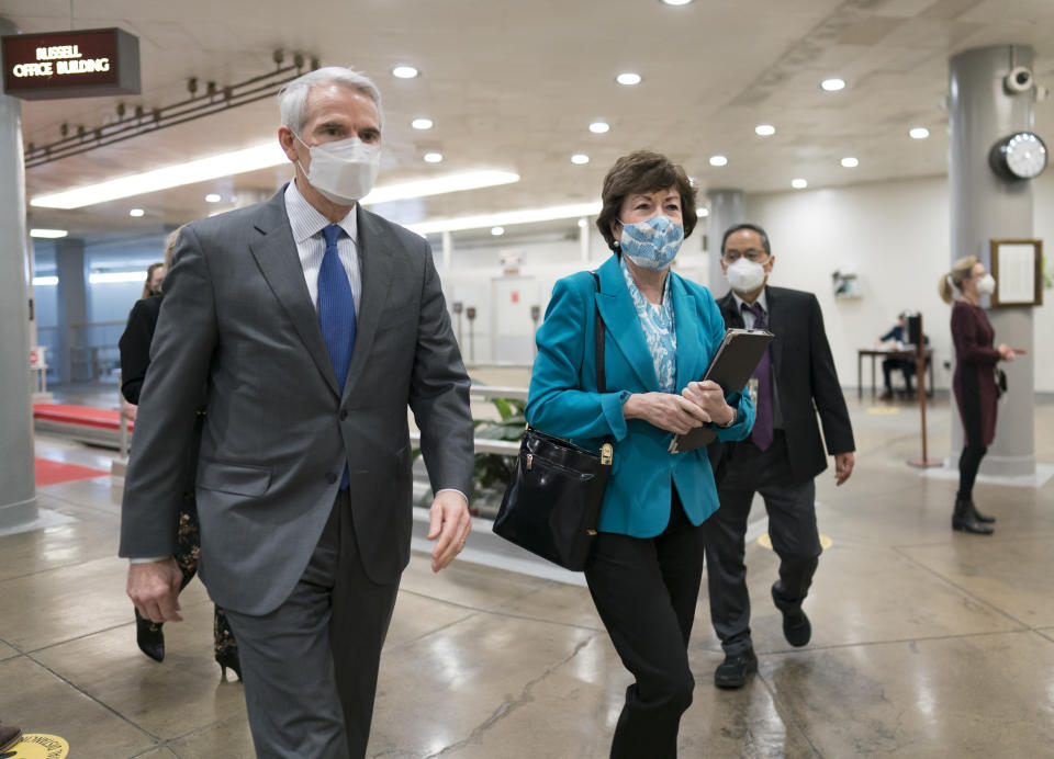Sen. Rob Portman, R-Ohio, left, and Sen. Susan Collins, R-Maine, arrive for votes on President Joe Biden's cabinet nominees, at the Capitol in Washington, Thursday, Feb. 25, 2021. (AP Photo/J. Scott Applewhite)