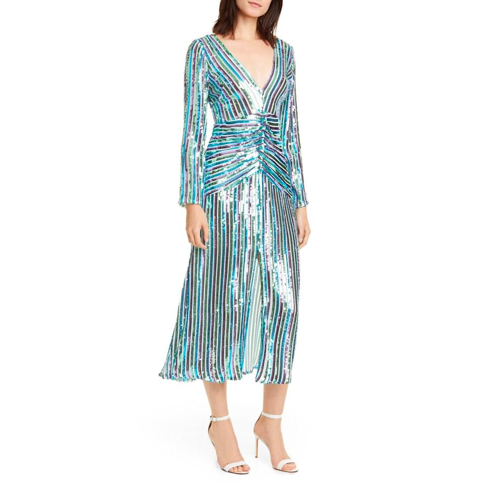 """A sparkly dress in a relaxed silhouette is what you need for a wedding with an after-party that's expected to last until the early morning hours. $545, Nordstrom. <a href=""""https://shop.nordstrom.com/s/rixo-emmy-sequin-stripe-long-sleeve-maxi-dress/5372364?"""">Get it now!</a>"""