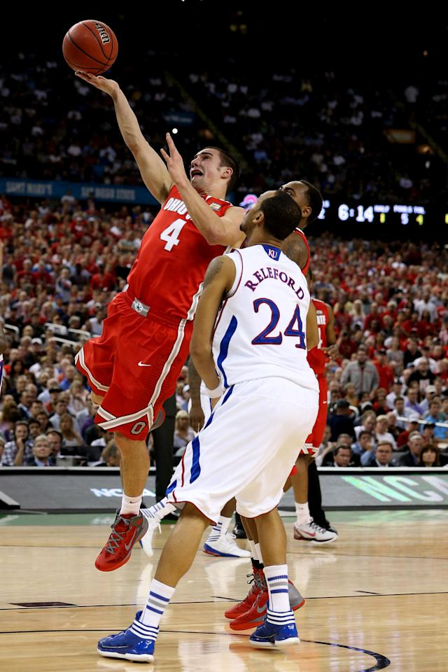NEW ORLEANS, LA - MARCH 31: Aaron Craft #4 of the Ohio State Buckeyes puts up a shot against Travis Releford #24 of the Kansas Jayhawks during the National Semifinal game of the 2012 NCAA Division I Men's Basketball Championship at the Mercedes-Benz Superdome on March 31, 2012 in New Orleans, Louisiana. (Photo by Jeff Gross/Getty Images)