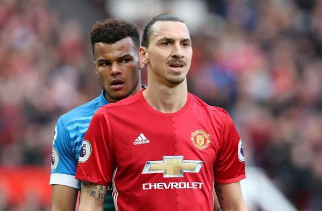 Tyrone Mings (left) and Zlatan Ibrahimovic clashed at Old Trafford