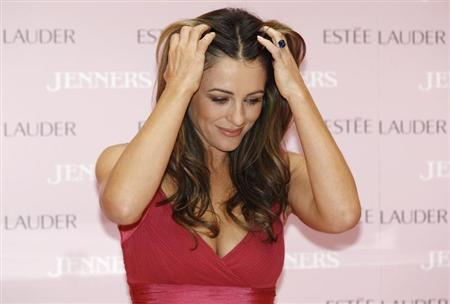 Actress and model Liz Hurley wears her engagement ring as she attends a breast cancer awareness launch at a department store in Edinburgh, Scotland