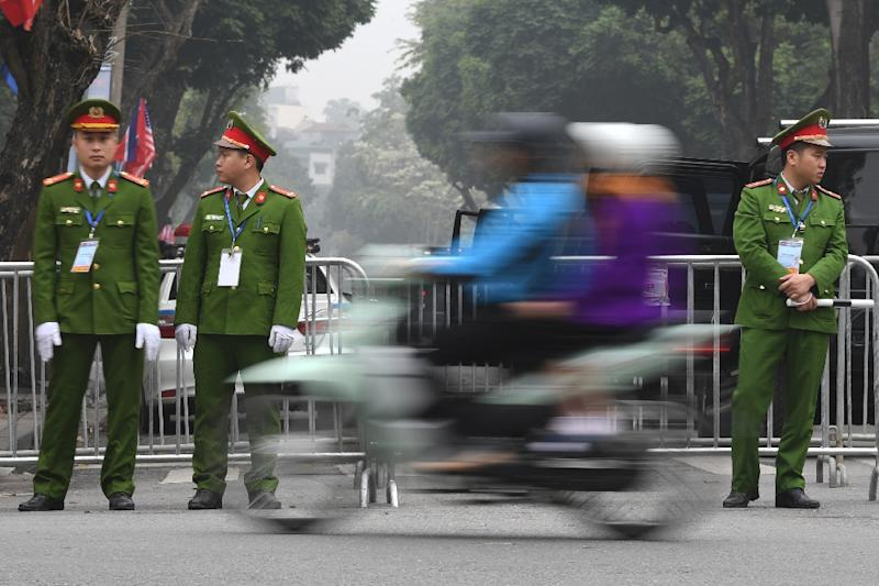 On guard: Vietnam police on duty in Hanoi