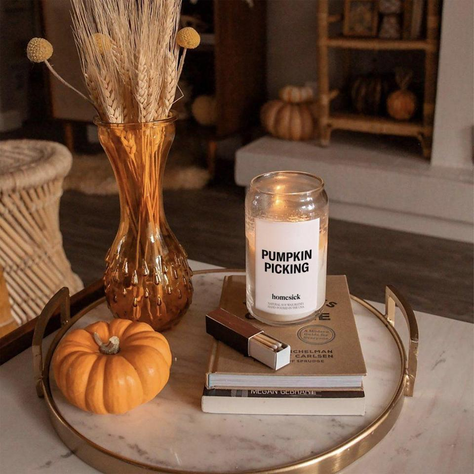 """<p>Known for its candles that smell like your home state, <a href=""""https://www.housebeautiful.com/shopping/home-accessories/a28699371/homesick-candles-diffuser-oils/"""" rel=""""nofollow noopener"""" target=""""_blank"""" data-ylk=""""slk:Homesick Candles"""" class=""""link rapid-noclick-resp"""">Homesick Candles</a> just dropped its popular <a href=""""https://homesick.com/collections/fall-favorites"""" rel=""""nofollow noopener"""" target=""""_blank"""" data-ylk=""""slk:Fall Favorites collection"""" class=""""link rapid-noclick-resp"""">Fall Favorites collection</a>. From a pumpkin-scented candle to a candle that smells like a freshly picked apple, the autumn lineup features candles that will bring back your favorite fall memories <em>and</em> get you excited for the new season just a couple weeks away. So even if you can't go to a pumpkin patch or an apple orchard amid the pandemic this year, you can still fill your home with the coziest fall scents. To help you get started, we've highlighted some favorites below. But you'll want to act fast because some of the candles in Homesick's Fall Favorites lineup are already selling out. </p>"""