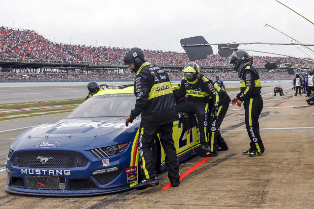 Paul Menard (21) climbs out of his car as Matt Crafton prepares to relieve him during a NASCAR Cup Series auto race at Talladega Superspeedway in Talladega, Ala., Sunday, Oct. 13, 2019. (AP Photo/Butch Dill)