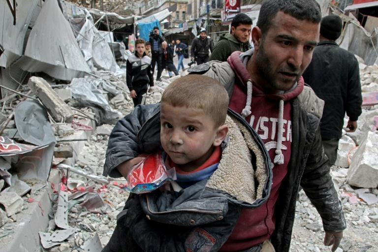 Intense air strikes by Syrian government forces, which have shown no sign of abating despite Russia's announcement of a truce, have reduced swathes of Idlib's towns to rubble (AFP Photo/Abdulaziz KETAZ)