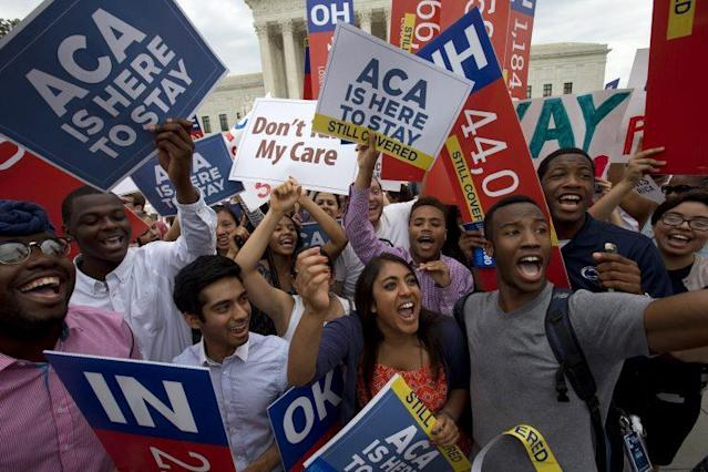 Students cheer as they hold up signs supporting the Affordable Care Act (ACA) after the Supreme Court decided that the ACA may provide nationwide tax subsidies, outside Supreme Court in Washington on June 25, 2015. (Photo: AP/Jacquelyn Martin)