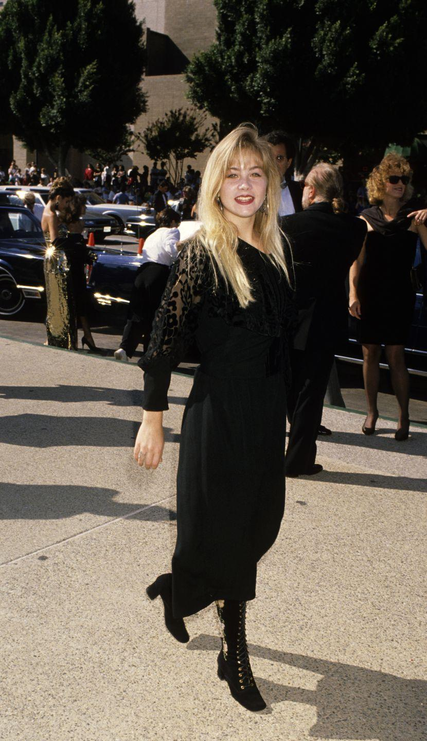<p>Applegate wore all-black and big bangs to the Emmy Awards in 1989.</p>