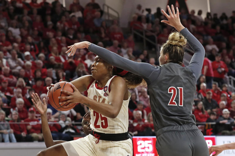 North Carolina State forward Kayla Jones (25) drives to the basket while Louisville forward Kylee Shook (21) defends during the second half of an NCAA college basketball game in Raleigh, N.C., Thursday, Feb. 13, 2020. (AP Photo/Gerry Broome)