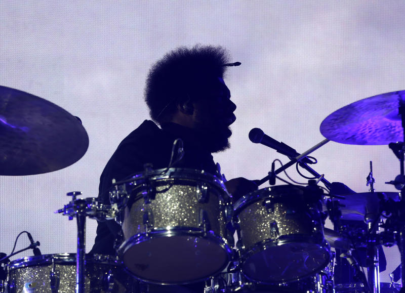 This Jan. 30, 2014 photo shows Questlove performing with the The Roots at a concert next to the Bud Light Hotel in New York. The temporarily renamed hotel moored on the Hudson River, is Norwegian Cruise Line's new ship Norwegian Getaway, and is acting as a floating hotel for fans and a site for hosting Super Bowl-related events. Bud Light Hotel is also taking over the Intrepid Sea, Air & Space Museum, including the deck of the retired military ship, which is permanently docked in the pier adjacent to Pier 88, the dock for Getaway. Concerts and other events will be held onboard for guests connected to Bud Light's retailers, partners and VIPs. (AP Photo)