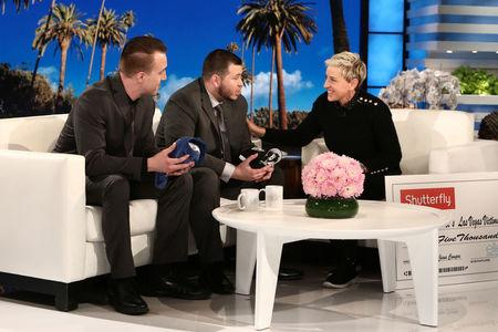 "Stephen Schuck and security guard Jesus Campos of the Mandalay Bay Resort and Casino in Las Vegas, are interviewed by host Ellen DeGeneres during the taping of  ""The Ellen DeGeneres Show"" in Burbank, California in this photo released October 18, 2017.   Michael Rozman/Warner Bros./Handout via REUTERS"