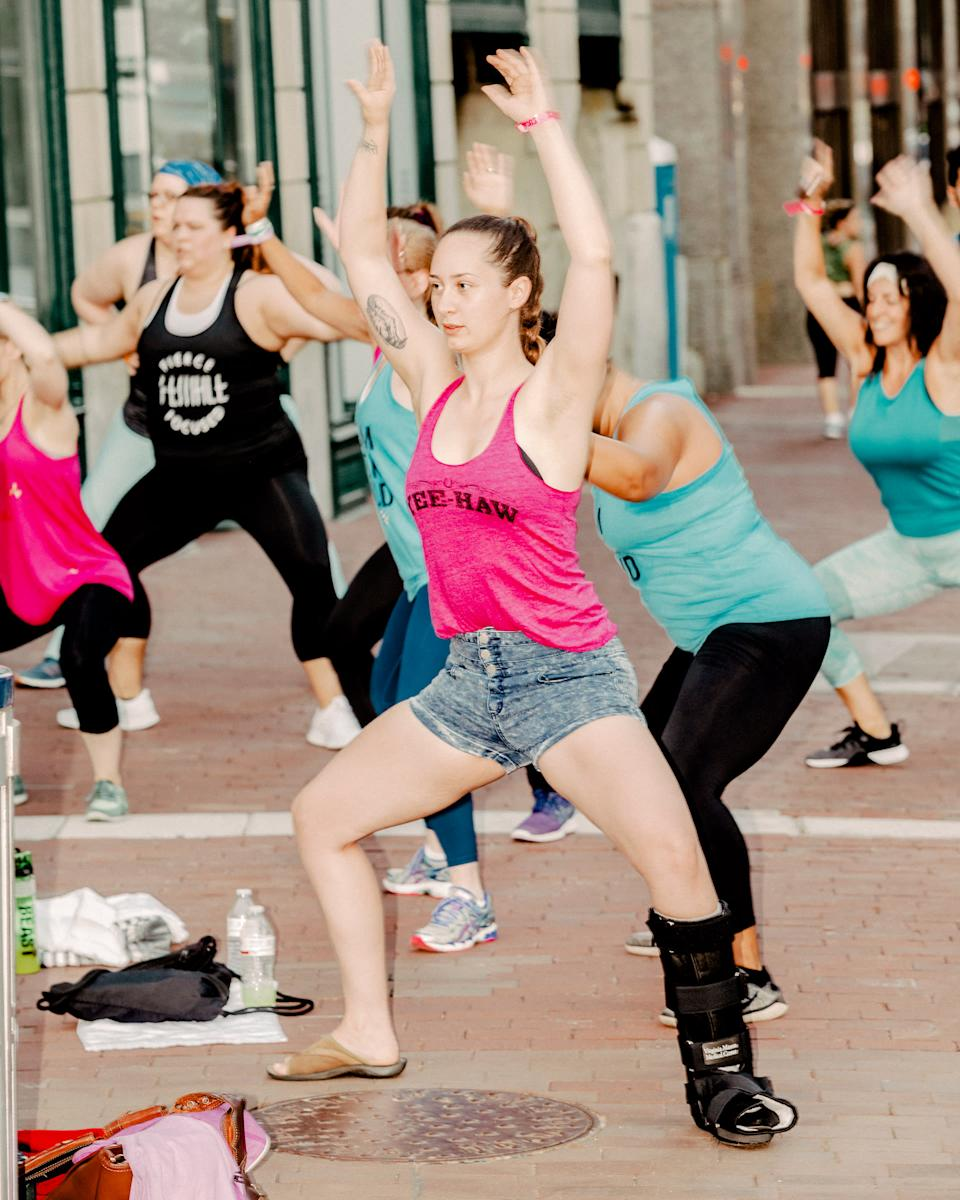 Attendees at Beachbody's Coach Summit in July 2019 in Indianapolis take part in a group workout | Evan Jenkins for TIME