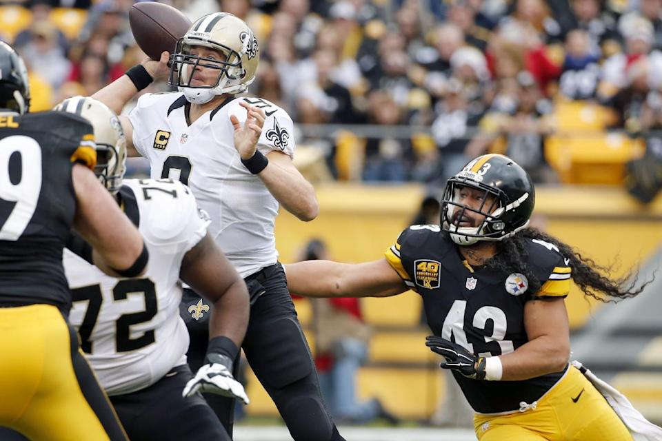 Pittsburgh Steelers strong safety Troy Polamalu (43) pressures New Orleans Saints quarterback Drew Brees (9) in the first quarter of the NFL football game, Sunday, Nov. 30, 2014, in Pittsburgh. (AP Photo/Gene J. Puskar)