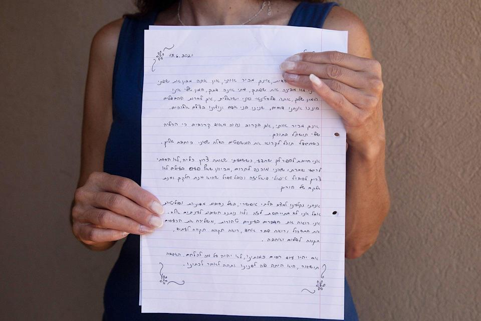 Idit Harel Segal, who donated a kidney to a Palestinian child from the Gaza Strip, holds with the letter she wrote to the boy, handwritten in Hebrew before giving him an Arabic translation, in her home in Eshhar, northern Israel