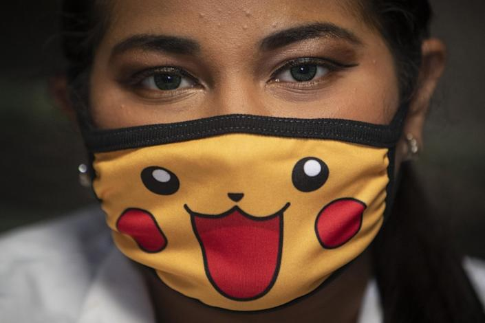 """A doctor wears a face mask as a precautionary measure against the spread of the new coronavirus as she waits for patients. <span class=""""copyright"""">(Inti Ocon / AFP/Getty Images)</span>"""