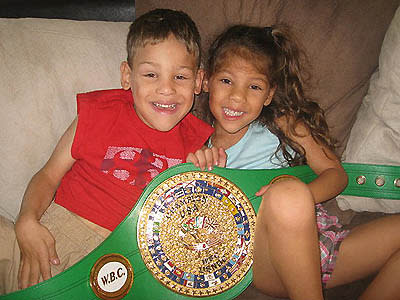 Edwin Rodriguez Jr. and twin sister Serena pose with their dad's title belt