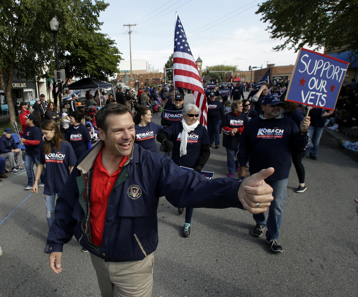 Kobach gives a thumbs-up sign during a parade on Sept. 29, 2018, in Overland Park, Kan. (Photo: Charlie Riedel/AP)