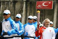 Gezen runs with the Olympic Torch in Istanbul on April 3, 2008