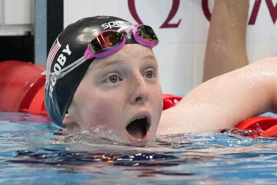 Lydia Jacoby, of the United States, reacts after winning the final of the women's 100-meter breaststroke at the 2020 Summer Olympics, Tuesday, July 27, 2021, in Tokyo, Japan. (AP Photo/Petr David Josek)
