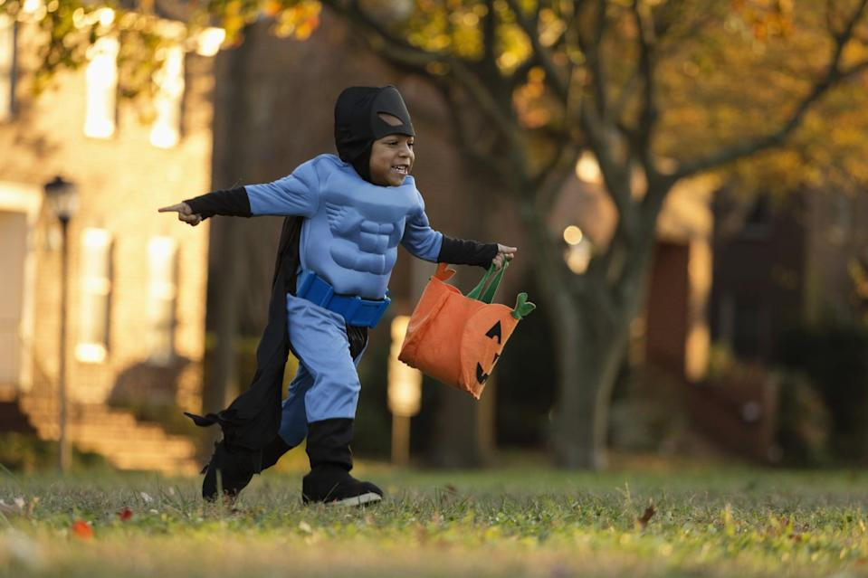 """<p>Whether in the yard or inside the house, hide wrapped candies all over the place and set your kids loose with their trick-or-treat buckets. Don't forget to hide some of the candies you like, because the <a href=""""https://www.popsugar.com/family/Letterfolk-Halloween-Parent-Candy-Tax-Form-45270184"""" class=""""link rapid-noclick-resp"""" rel=""""nofollow noopener"""" target=""""_blank"""" data-ylk=""""slk:parent candy tax"""">parent candy tax</a> is more important than ever in 2020! </p> <p>Related: <a href=""""https://www.popsugar.com/family/halloween-safety-tips-for-families-amid-coronavirus-47728012?utm_medium=partner_feed&utm_source=yahoo_publisher&utm_campaign=related%20link"""" rel=""""nofollow noopener"""" target=""""_blank"""" data-ylk=""""slk:Is Trick-or-Treating Safe Amid the COVID Pandemic? We Asked a Pediatrician For Advice"""" class=""""link rapid-noclick-resp"""">Is Trick-or-Treating Safe Amid the COVID Pandemic? We Asked a Pediatrician For Advice</a></p>"""