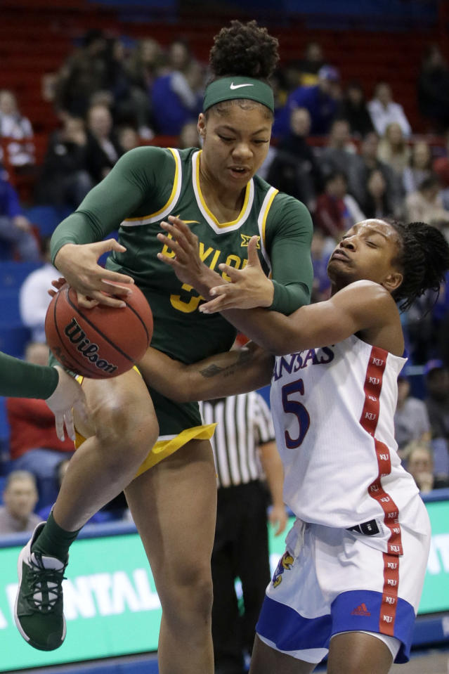 Baylor guard Trinity Oliver (3) and Kansas guard Aniya Thomas (5) vie for a rebound during the second half of an NCAA college basketball game in Lawrence, Kan., Wednesday, Jan. 15, 2020. (AP Photo/Orlin Wagner)