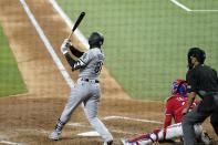 Chicago White Sox's Luis Robert follows through on a three-run double next to Texas Rangers catcher Jose Trevino and umpire Gabe Morales during the fourth inning of a baseball game in Arlington, Texas, Friday, Sept. 17, 2021. (AP Photo/Tony Gutierrez)