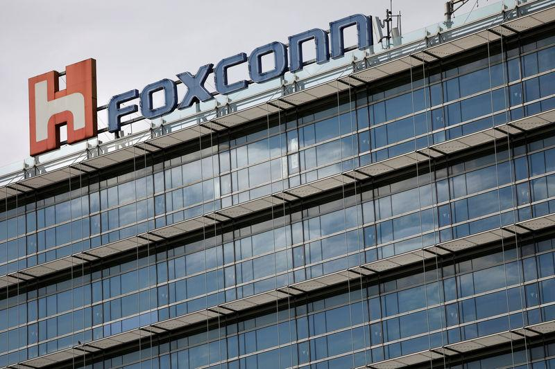 FILE PHOTO: The logo of Foxconn, the trading name of Hon Hai Precision Industry, is seen on top of the company's building in Taipei, Taiwan March 30, 2018. REUTERS/Tyrone Siu