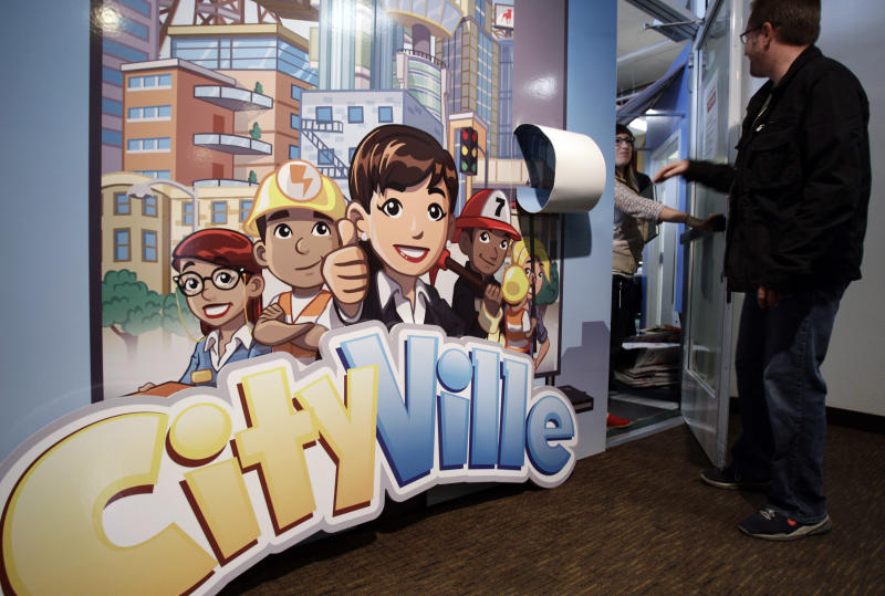 """In this June 2, 2011 photo, workers enter the CityVille game room at Zynga headquarters in San Francisco, Thursday, June 2, 2011. Based on papers filed Friday, July1, 2011, Zynga, the online game maker behind """"FarmVille"""" and other popular Facebook pastimes, is going public. (AP Photo/Paul Sakuma)"""