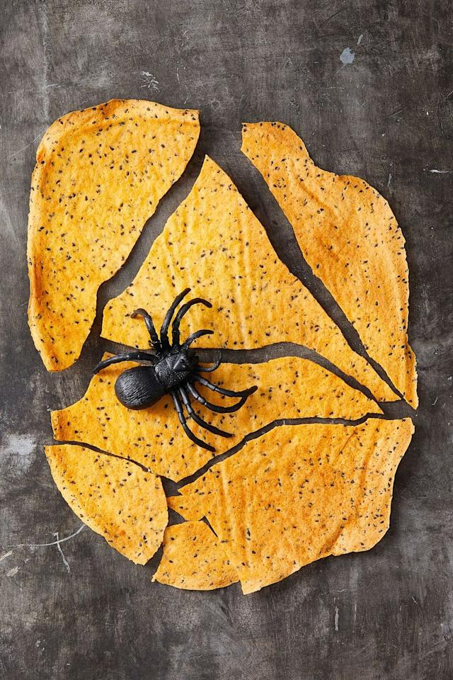 """<p>Speckle orange crackers with black sesame seeds for a spooky on-theme  snack.</p><p><em><a href=""""https://www.goodhousekeeping.com/food-recipes/a28542701/cheddar-crackers-recipe/"""" target=""""_blank"""">Get the recipe for Cheddar Crackers »</a></em> </p>"""