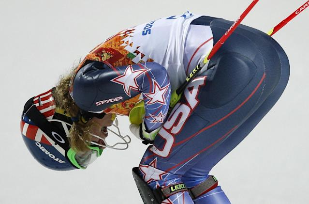 United States' Mikaela Shiffrin celebrates winning the gold medal in the women's slalom at the Sochi 2014 Winter Olympics, Friday, Feb. 21, 2014, in Krasnaya Polyana, Russia. (AP Photo/Christophe Ena)