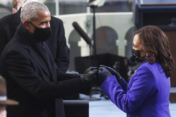 <p>Obama and Harris exchange a joyful glance as they say a masked hello. </p>