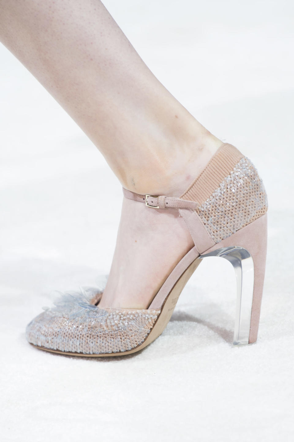 <p><i>Blush pink heels with blue feathers from the SS18 Valentino collection. (Photo: ImaxTree) </i></p>