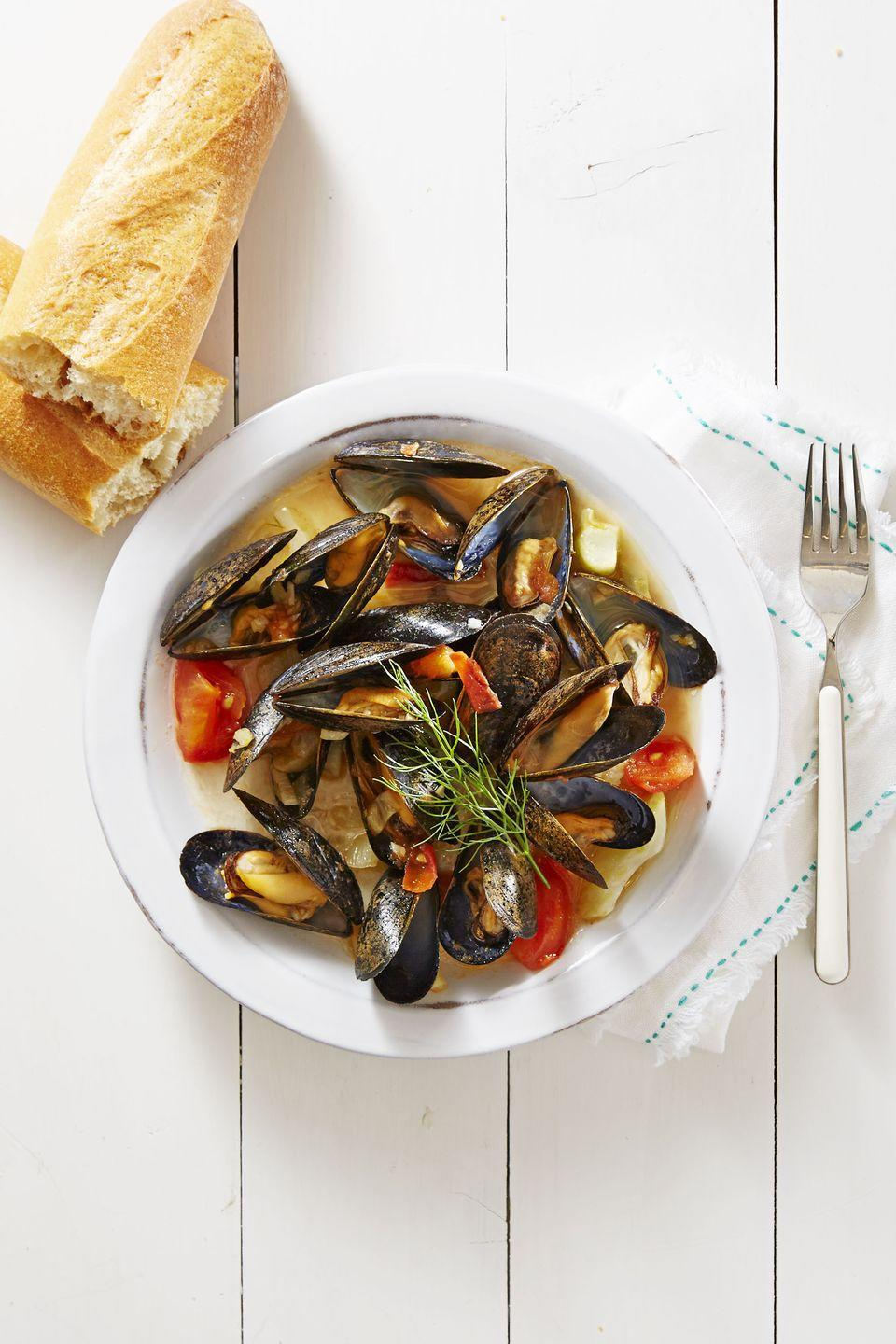 """<p>A crowd-friendly first course that everyone can get behind! These tender mussels bust open in a liqueur-based broth in just 20 minutes.</p><p><a href=""""https://www.goodhousekeeping.com/food-recipes/a39949/mussels-provencal-recipe/"""" rel=""""nofollow noopener"""" target=""""_blank"""" data-ylk=""""slk:Get the recipe for Mussels Provençal »"""" class=""""link rapid-noclick-resp""""><em>Get the recipe for Mussels Provençal »</em></a><br></p>"""