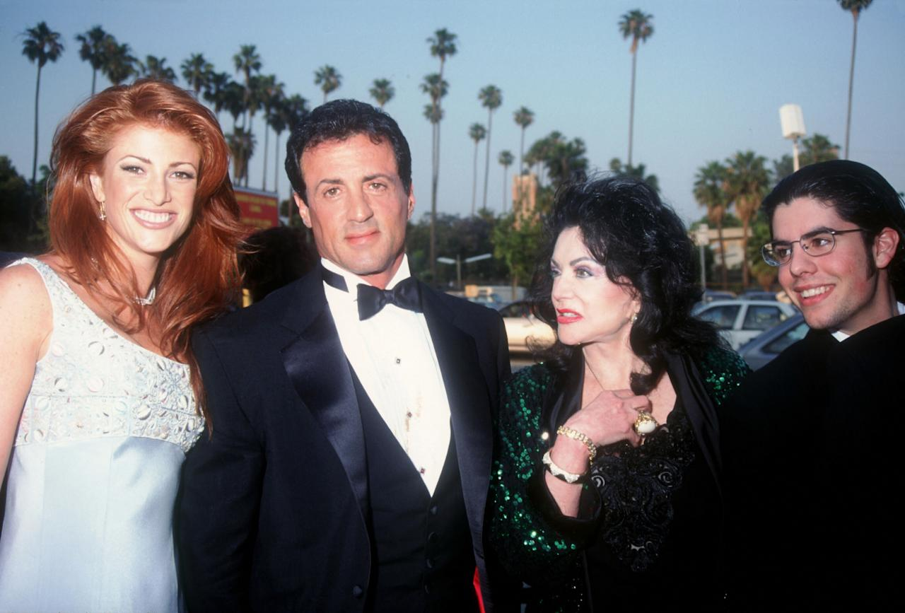 Action star Sylvester Stallone stands next to model Angie Everhart, his mother Jaqueline and son Sage at the first Annual Blockbuster Entertainment Awards June 3, 1995 in Los Angeles, CA. (Photo by Barry King/Liaison/Getty Images)