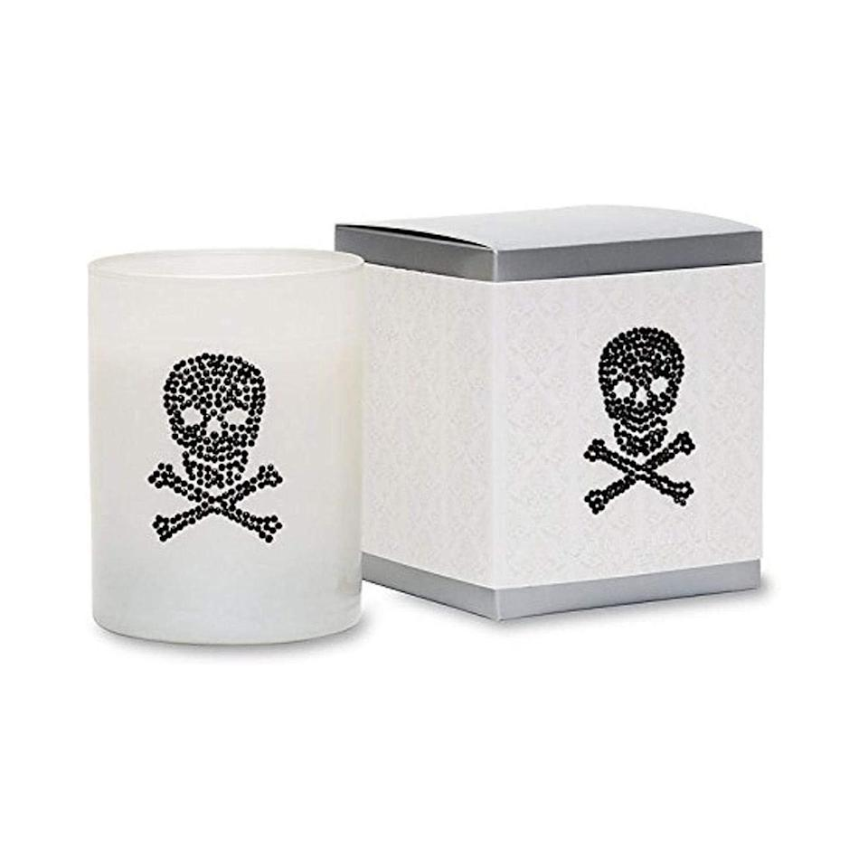 """A spooky chic candle, you say? Yes we do. Primal Elements' Skull and Bones candle lets you get festive for Halloween and also fills the room with a smoky sweet aroma that's balanced with notes of tobacco leaf and vanilla. And when you're done with the candle, you can always use it to spookify your house. $27.44, Amazon. <a href=""""https://www.amazon.com/Primal-Elements-Candle-Skull-Bones/dp/B00LXBPAAU"""" rel=""""nofollow noopener"""" target=""""_blank"""" data-ylk=""""slk:Get it now!"""" class=""""link rapid-noclick-resp"""">Get it now!</a>"""