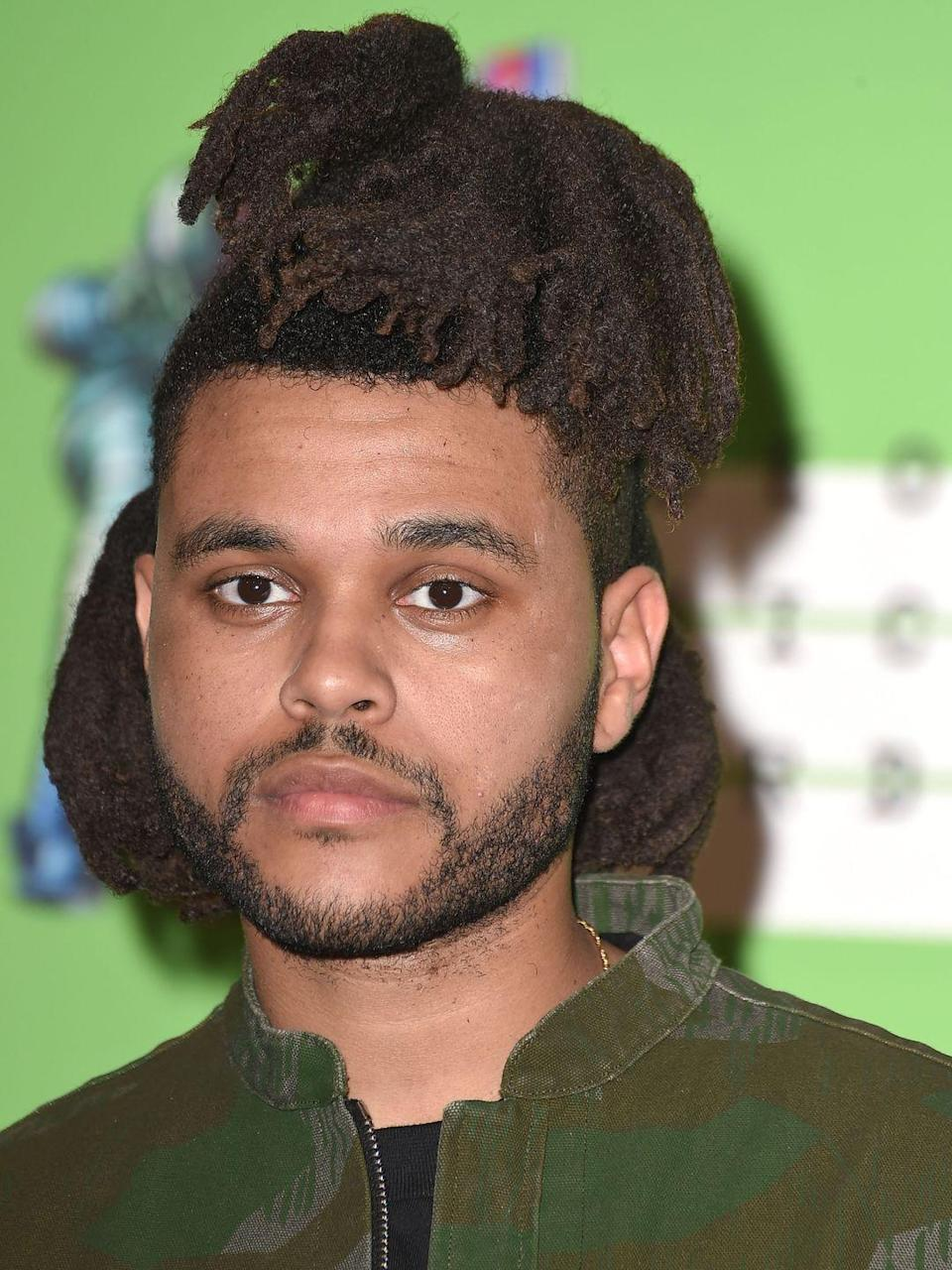<p>The Weeknd's top locs stood less straight here, almost creating a side bang look that we truly couldn't get enough of. </p>