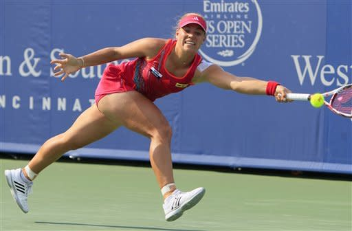 Angelique Kerber, of Germany, hits a forehand against Li Na, of China, during the women's final at the Western & Southern Open tennis tournament, Sunday, Aug. 19, 2012, in Mason, Ohio. (AP Photo/Al Behrman)