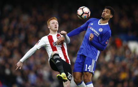 Brentford's Ryan Woods in action with Chelsea's Ruben Loftus-Cheek