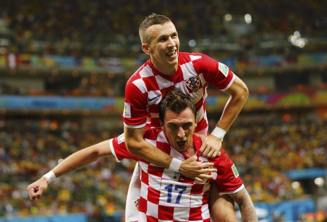 Croatia's Mario Mandzukic (bottom) celebrates after scoring a goal with teammate Ivan Perisic during their 2014 World Cup Group A soccer match against Cameroon at the Amazonia arena in Manaus June 18, 2014. REUTERS/Siphiwe Sibeko (BRAZIL - Tags: SOCCER SPORT WORLD CUP TPX IMAGES OF THE DAY) TOPCUP