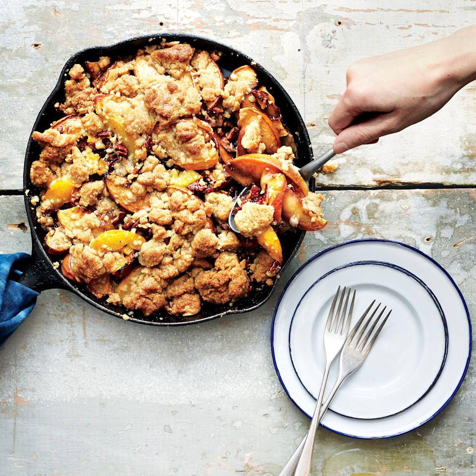 "We love any dessert cooked in a cast-iron skillet, but this one's really a treasure, since summer's best peaches can get extra-caramelized in this skillet crisp. <a href=""https://www.epicurious.com/recipes/food/views/iron-skillet-peach-crisp-56389711?mbid=synd_yahoo_rss"">See recipe.</a>"