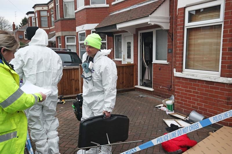 Forensics officers at the scene of a fire at a house on Wensley Avenue, Hull, where two people have died, including an eight-year-old.